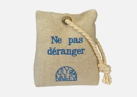 Embroidered do not disturb sign in linen